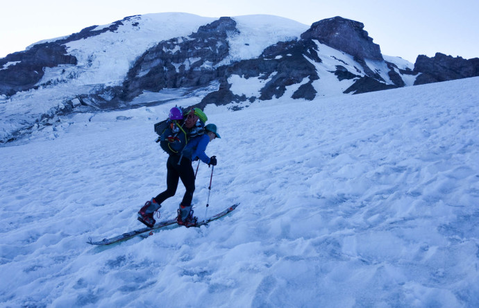 Katy skinning up Muir Snowfield. The iced-over suncups made for less-than-stellar traveling.