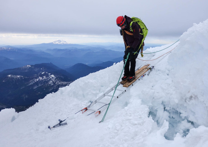 Brad crossing one of the ladders on the route