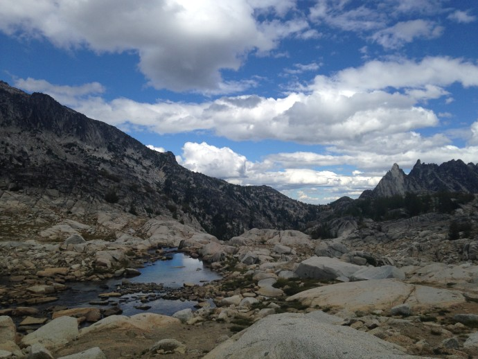 The trail weaves between these alpine lakes