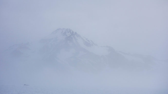 Glacier shaking off the whiteout